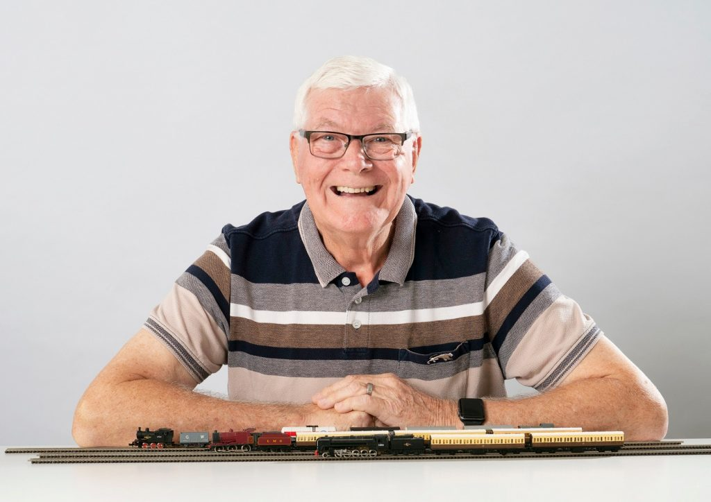 Darryl Ellwood with one of his beloved model trains.