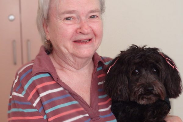 Pooch lapping up love from joyful seniors