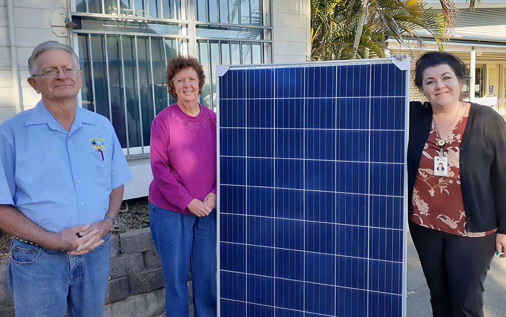 Jim Grounds and Robyn Freiberg from Rim FM and Samantha Caves from Carinity Fassifern Community Centre with one of the donated solar panels.
