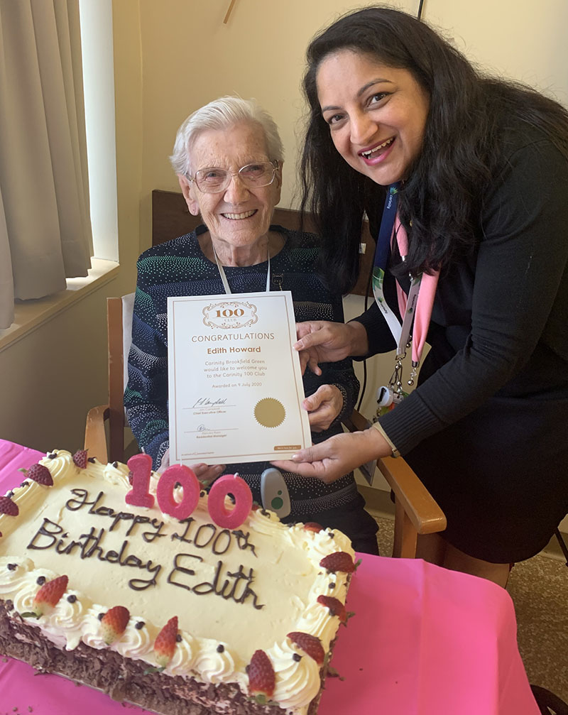 New centenarian Edith Howard with Carinity Brookfield Green Residential manager Renuka Ram.