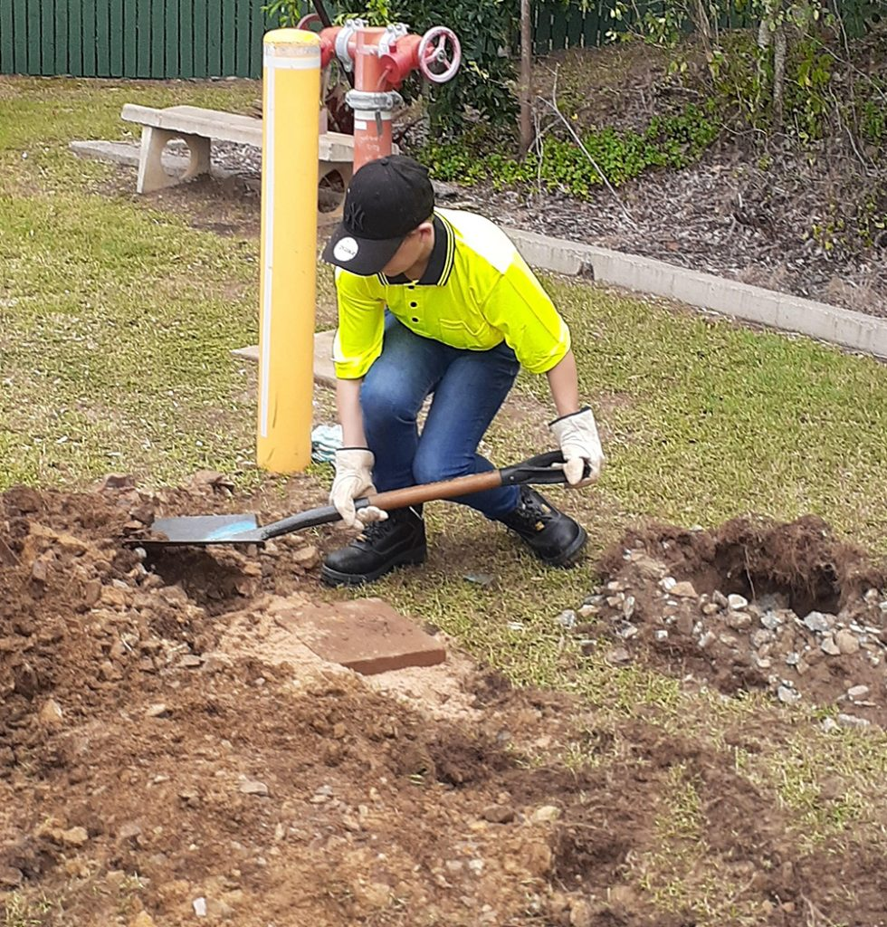 A young person from Carinity On Track undertaking work experience in Yeppoon.