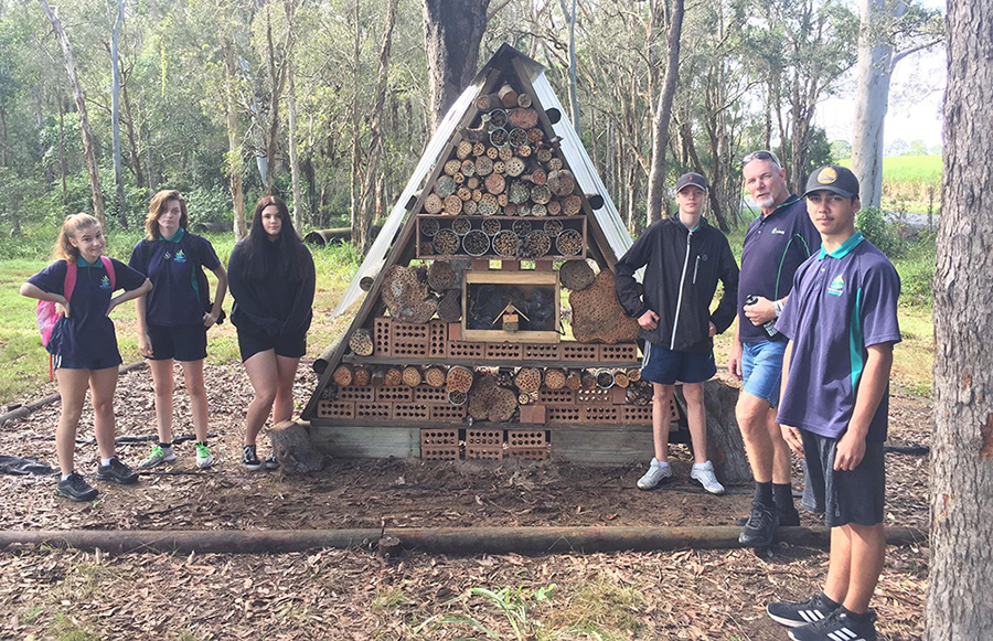 Carinity Education Glendyne students and teacher Justin Burnham with the bee hotel in the Land for Wildlife conservation area on the school campus in Hervey Bay.