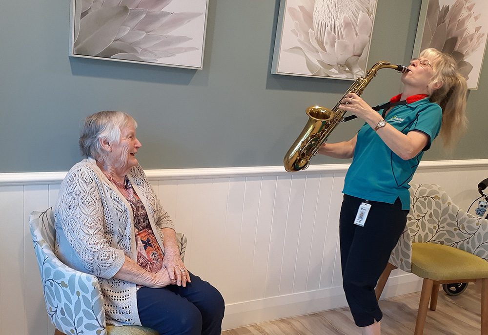 Francesca enjoys playing saxophone for Carinity Brookfield Green residents such as Fay Jones.