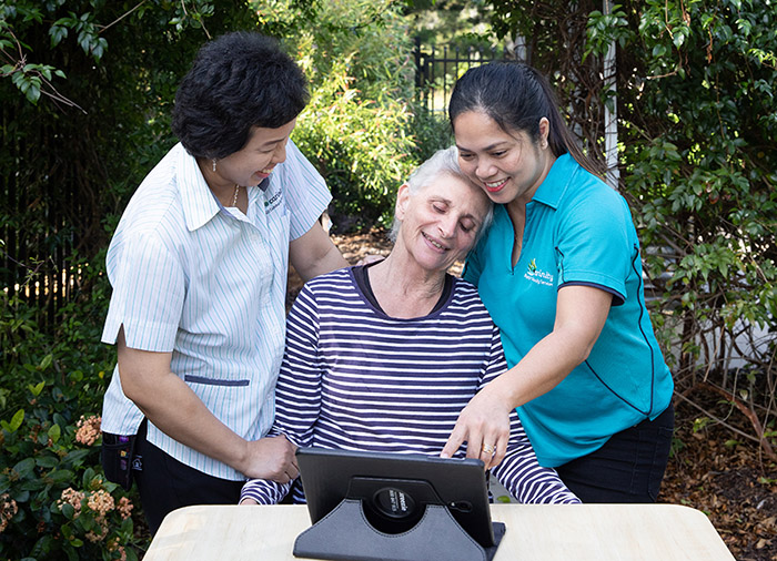 Carinity staff have taught aged care residents such as Irene Harm to do video calls with family
