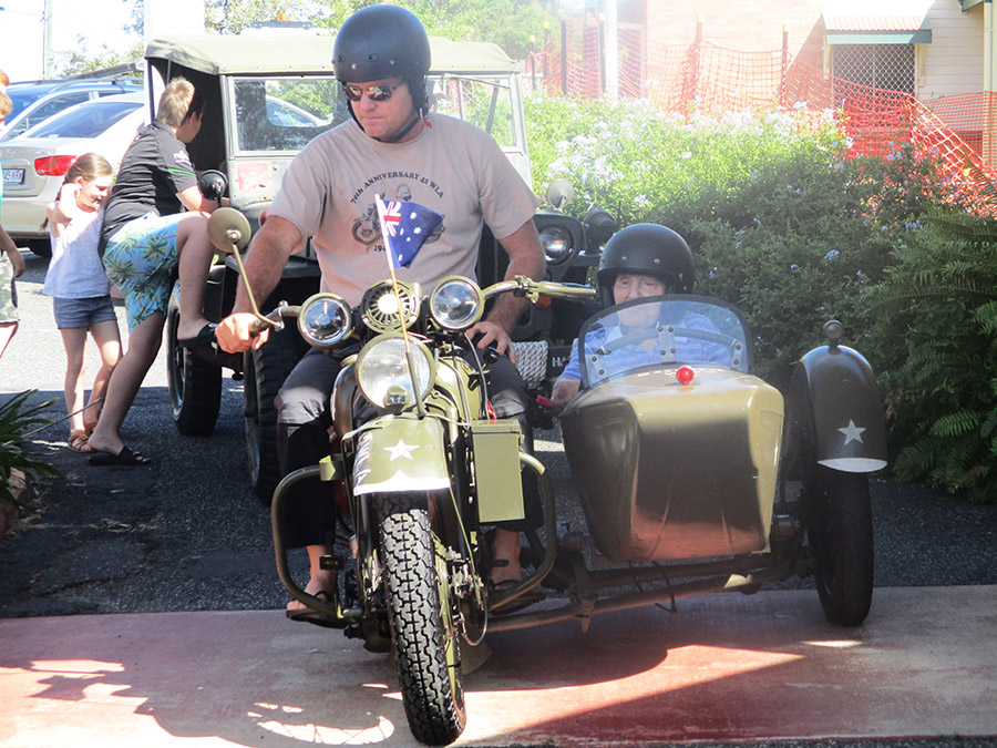Claude McKnight in the sidecar of a World War II Harley Davidson army motorcycle in 2019.