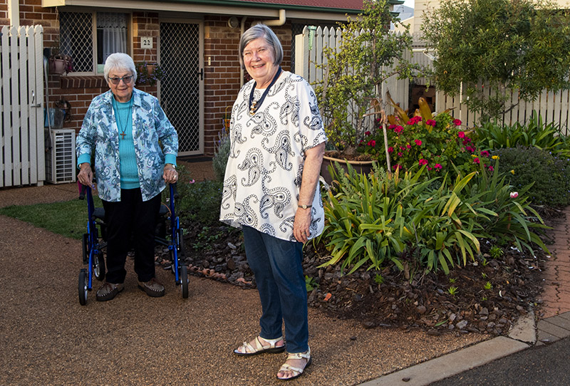 Joyce Larkens and Merilyn Playsted are neighbours living at the Carinity Brownesholme retirement village in Highfields.