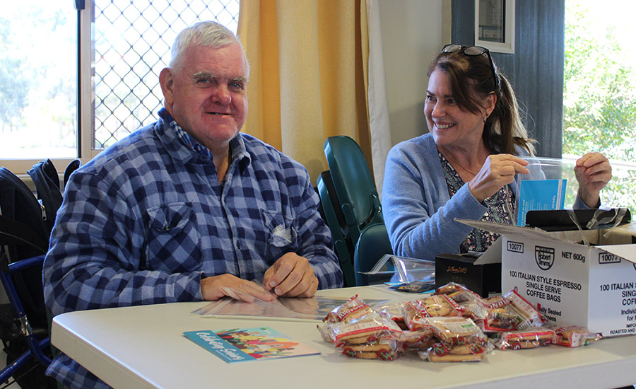 Carinity Our House Lifestyle Support Worker Louise Northey assists client Hugo Teske.