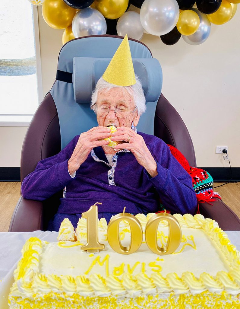 Mavis Cumner enjoys some birthday cake for her 100th birthday.