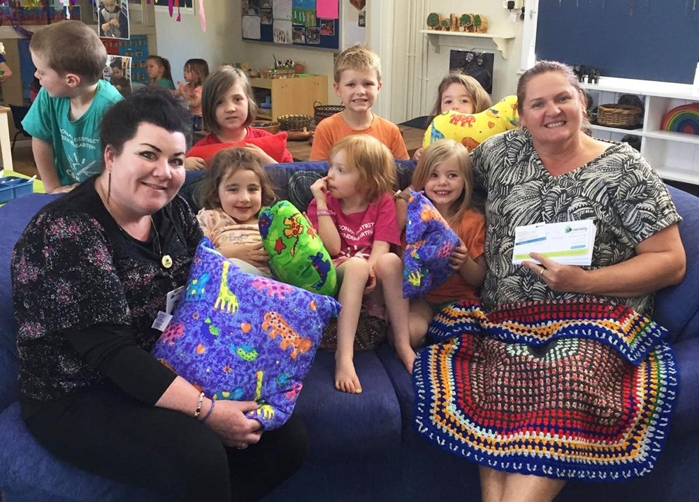 Carinity Fassifern Community centre gifted cushions, knee rugs and gift vouchers to Boonah District Kindergarten
