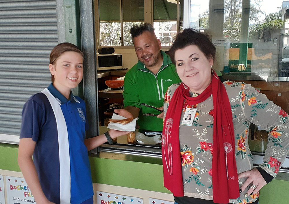 Samantha Caves from Carinity Fassifern Community Centre at the Boonah State School Breakfast Club.