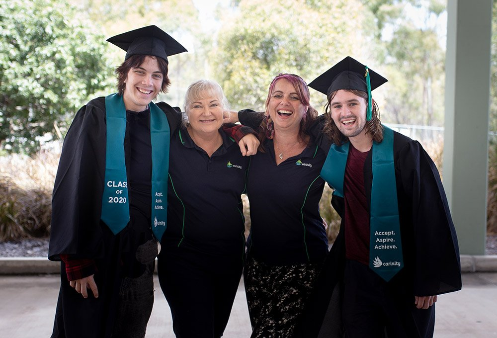 Carinity Education Gladstone Year 12 graduates River and Lochie with school Principal Jane Greenland and Youth Worker Mandy Hunter.