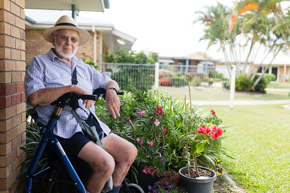 Wilhelm 'Bill' von Allmen at Carinity Shalom aged care with the shrubs he introduced to Australia