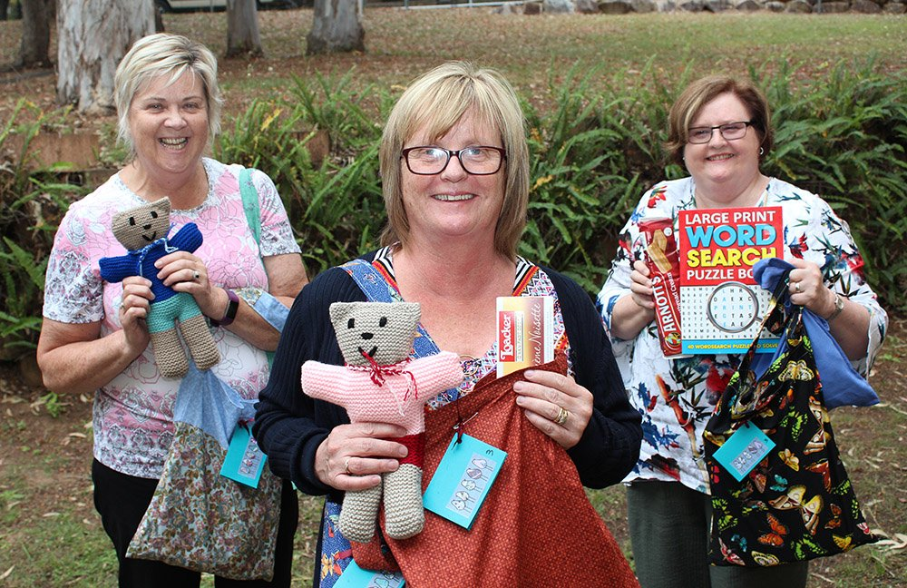 Carinity staff members Jo-Ann Jaap, Tina Larden and Janelle Heyse with care packs donated to Karinya Place residents by the Bridgeman Baptist Community Church Craft Group.
