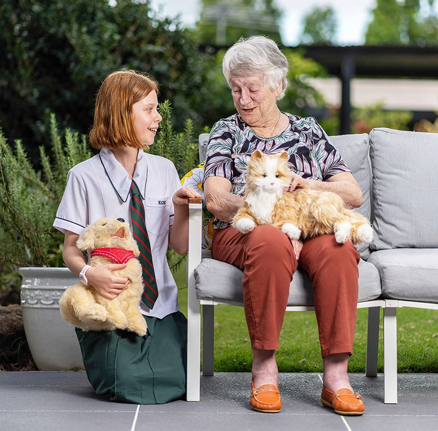 Kelvin Grove State College student Abbie Duncan and Carinity Hilltop aged care resident Betty Wright with the companion pets.