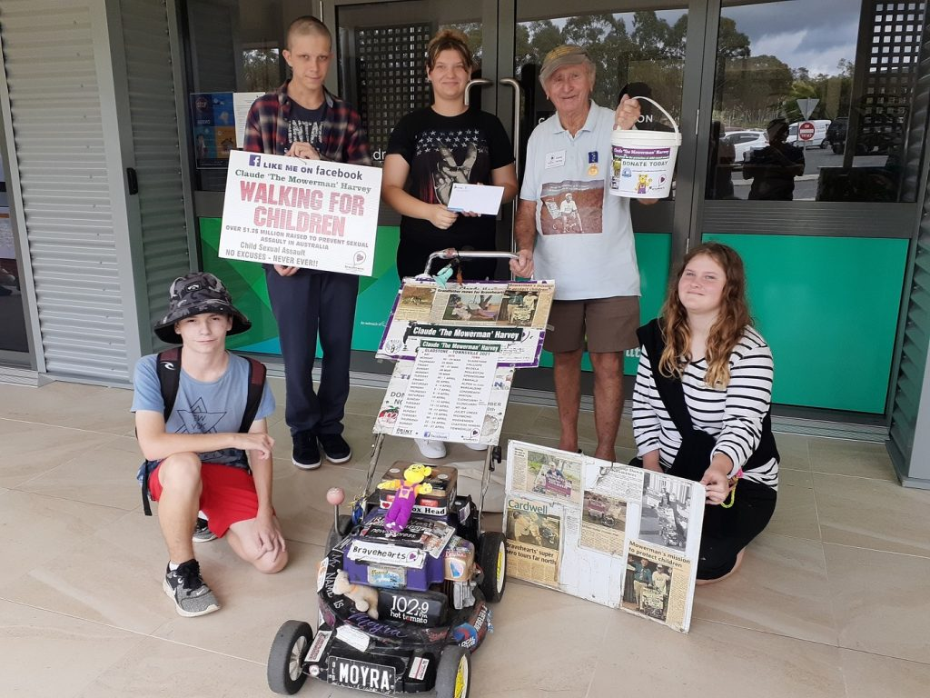 Claude 'The Mower Man' Harvey visited Carinity Education Gladstone on March 24 to accept the students' donation to Bravehearts.