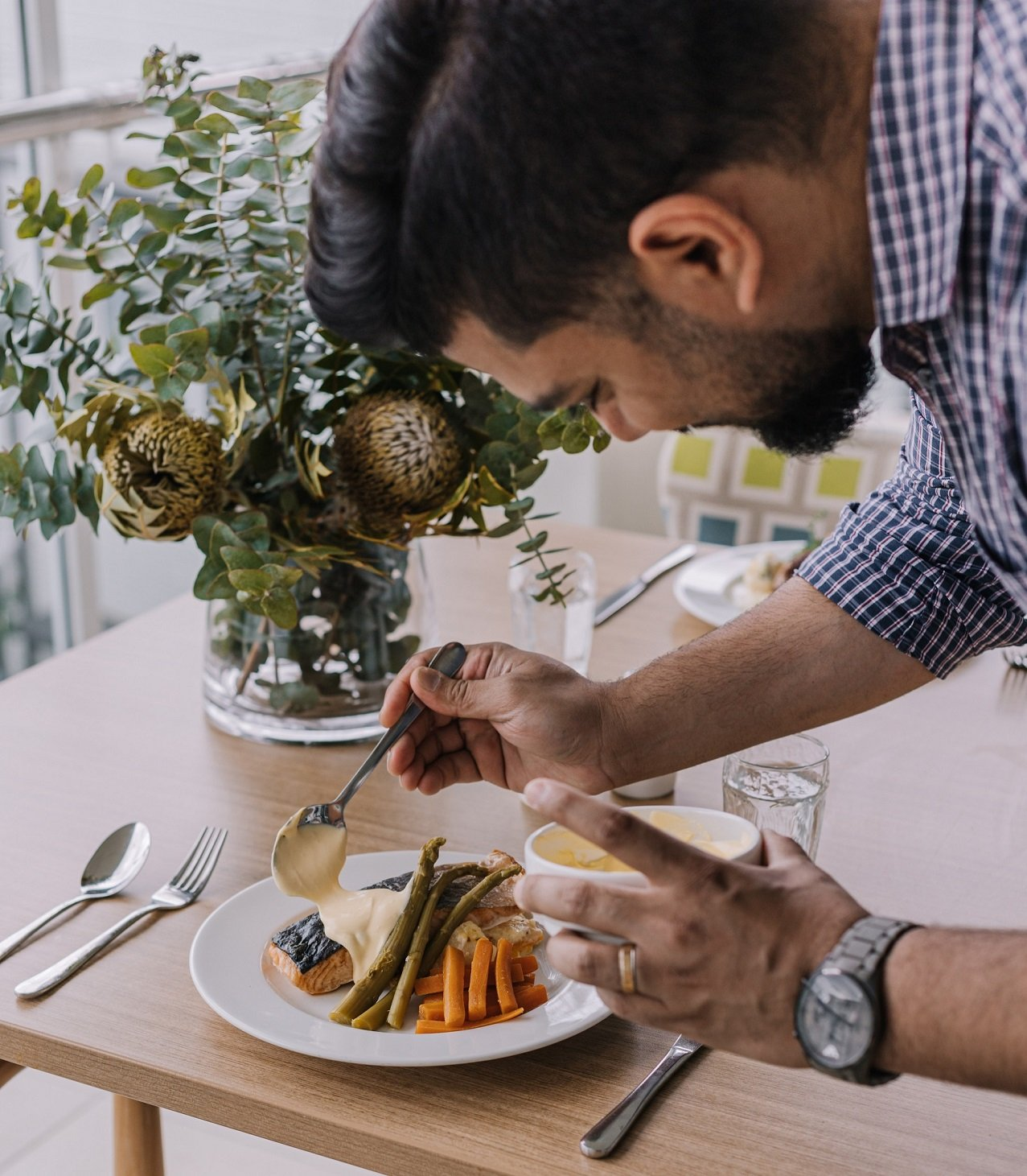 George Pratheesh puts the finishing touches to a resident's meal at the Carinity Cedarbrook aged care community.