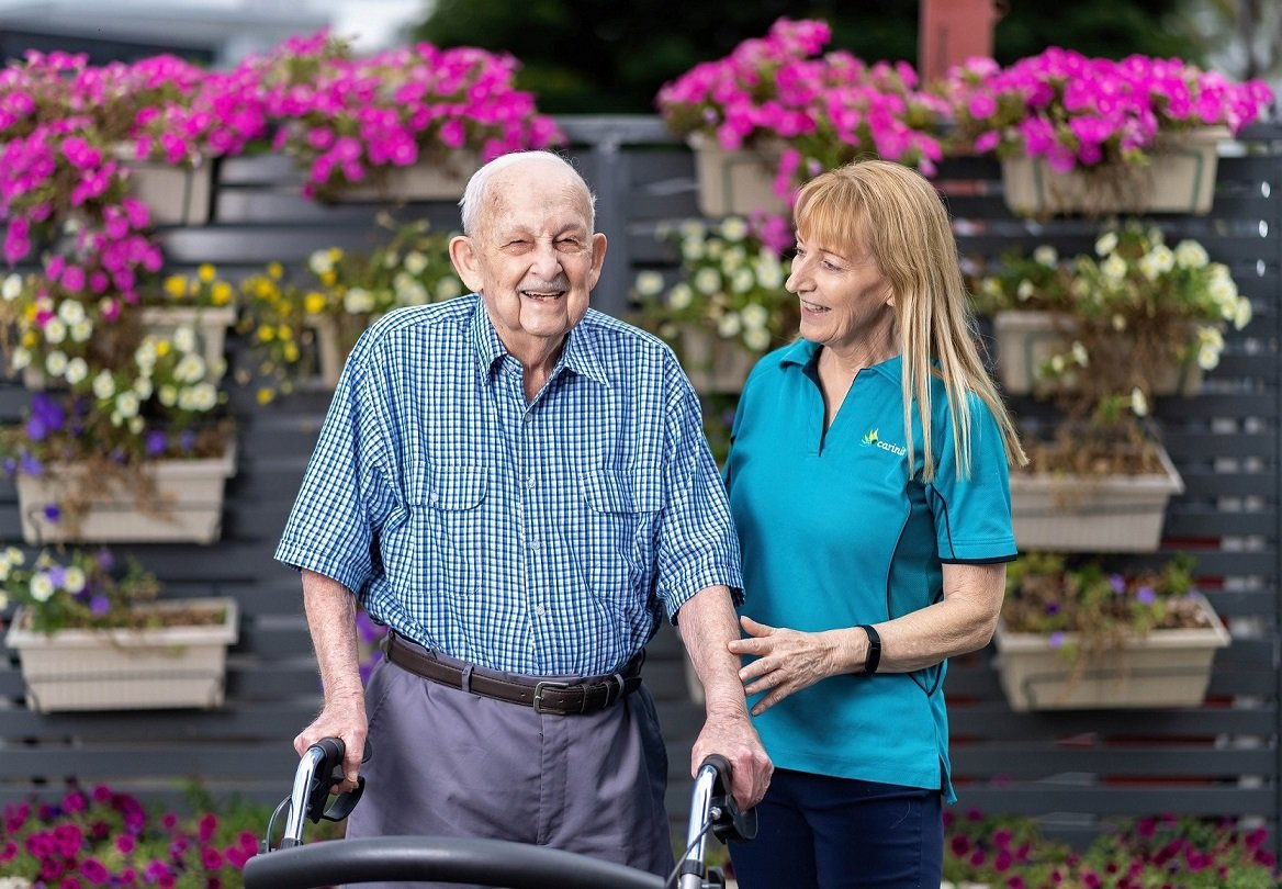 Mervyn Rick, with carer Lois Healy, moved to Carinity Hilltop residential aged care after receiving respite care there.