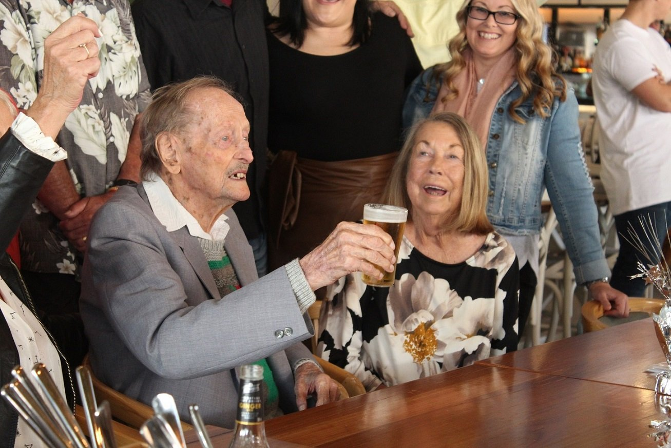 Gordon enjoys a beer with family at his 100th birthday party at Robina Pavilion.